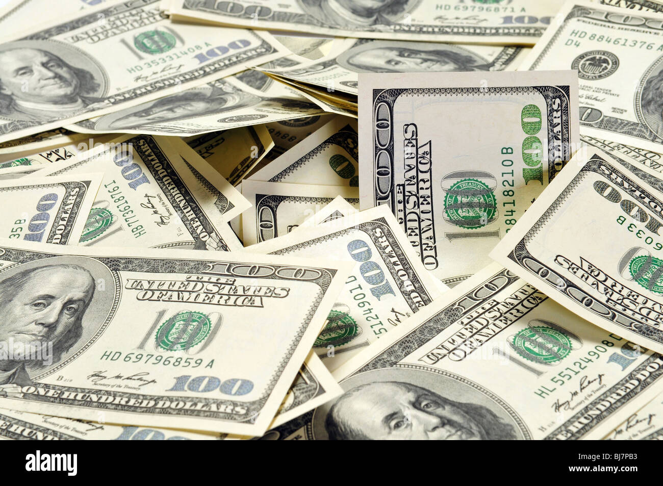 Pile of American dollars arranged as background - Stock Image