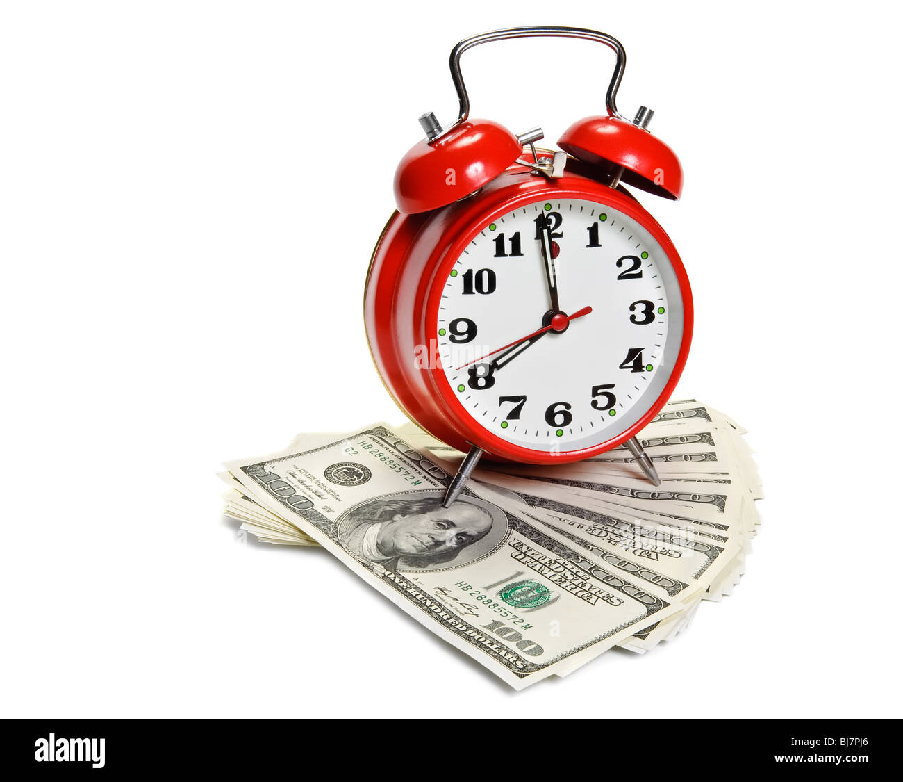 'Time is money' concept - classic alarm clock over dollars - Stock Image