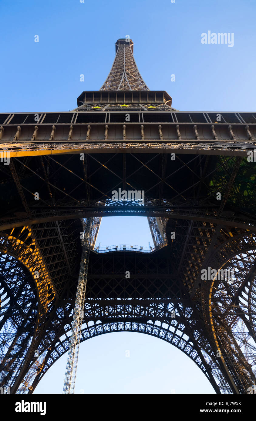 The Eiffel Tower seen from below / underneath, at dusk. Paris. France. - Stock Image