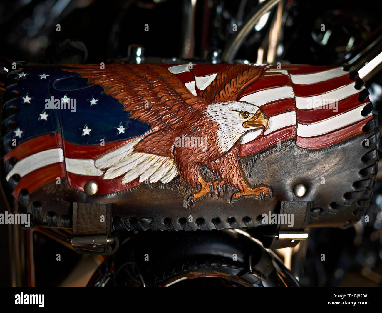 Great American eagle crest on a bikers leather pouch - Stock Image