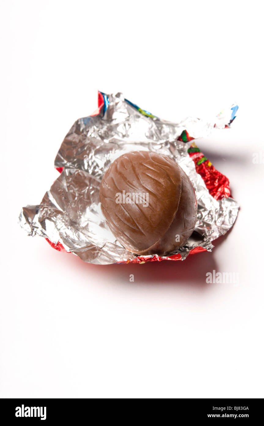 Easter chocolate egg unwrapped - Stock Image