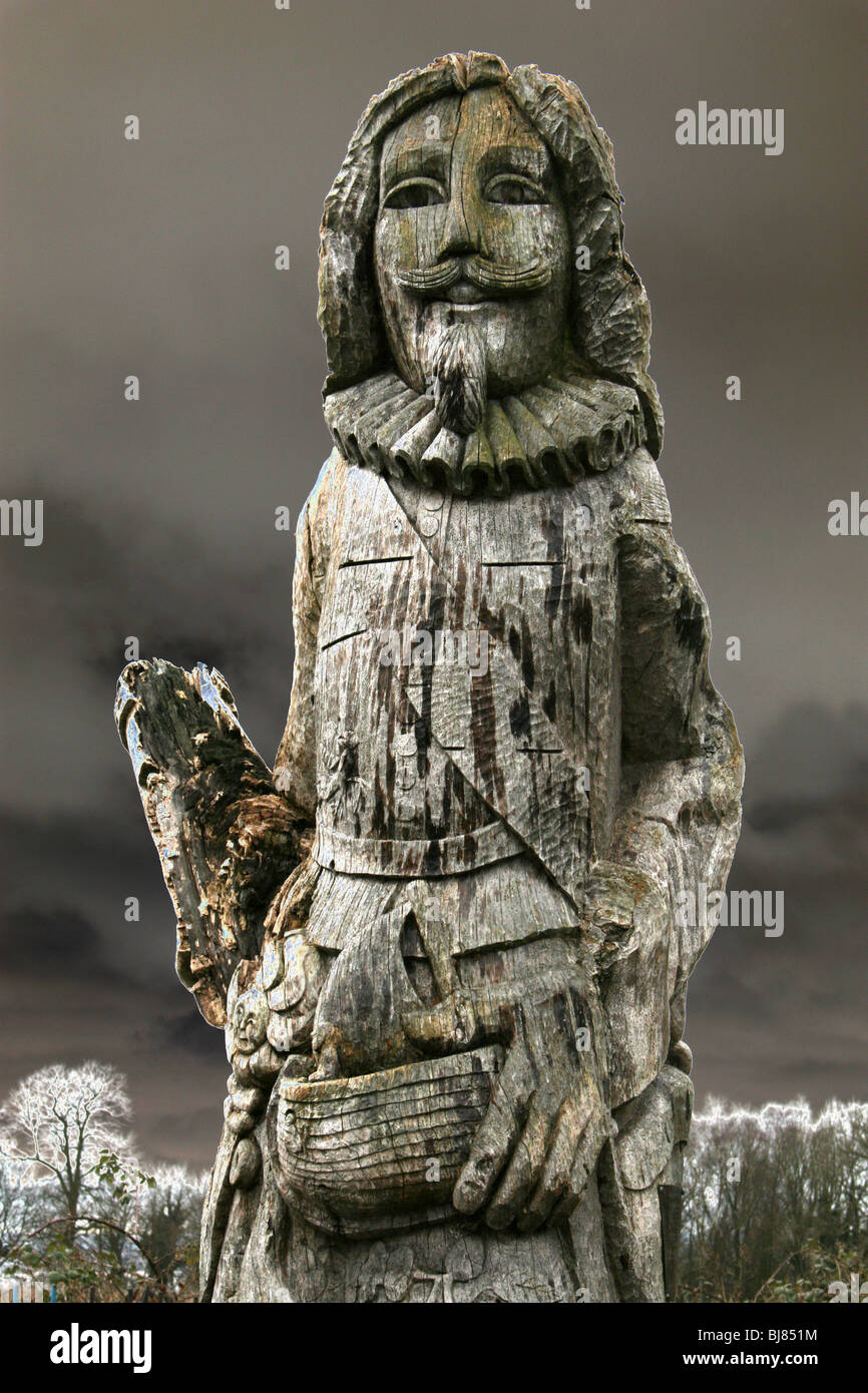 Carved Wooden Statue Of The Childe Of Hale With Solarised Photography Effect, Hale Village, Merseyside, UK - Stock Image