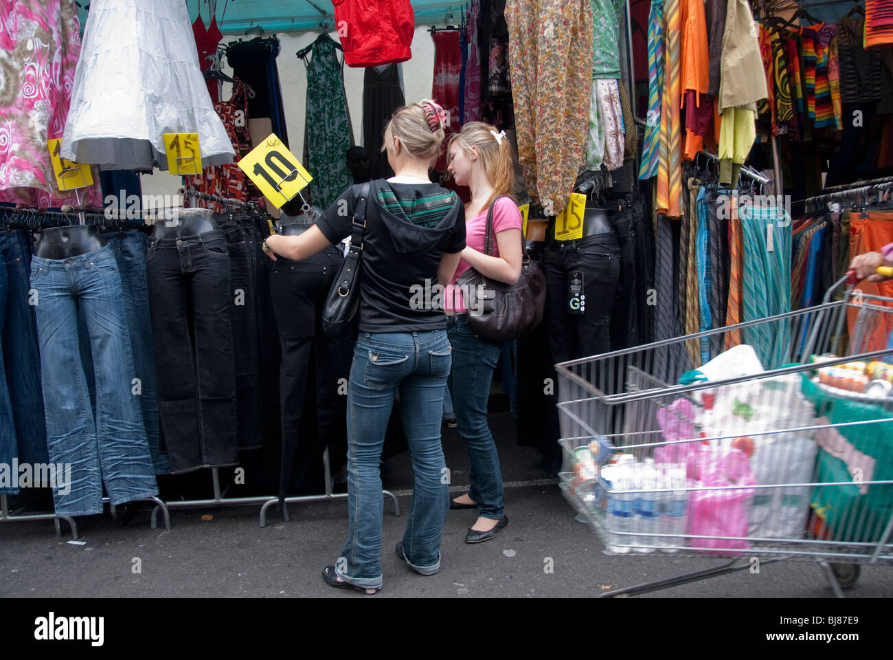 Attractive Paris, France, Female Teens Shopping, Clignancourt Flea Market Clothing Shop,  Display, Outside Second Hand Store