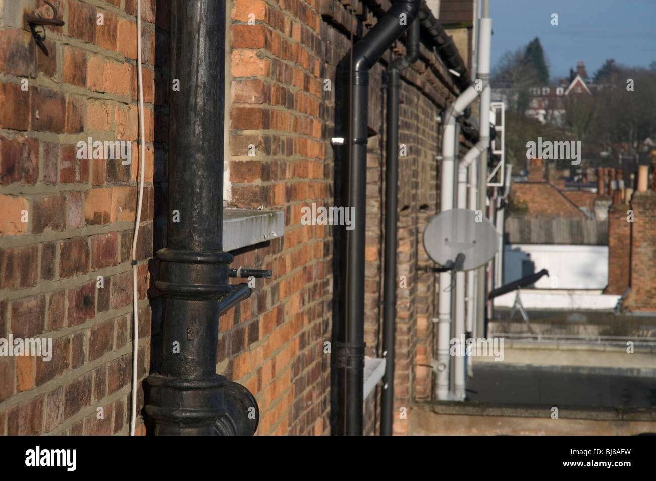 Drain Pipe and Brickwork - Stock Image