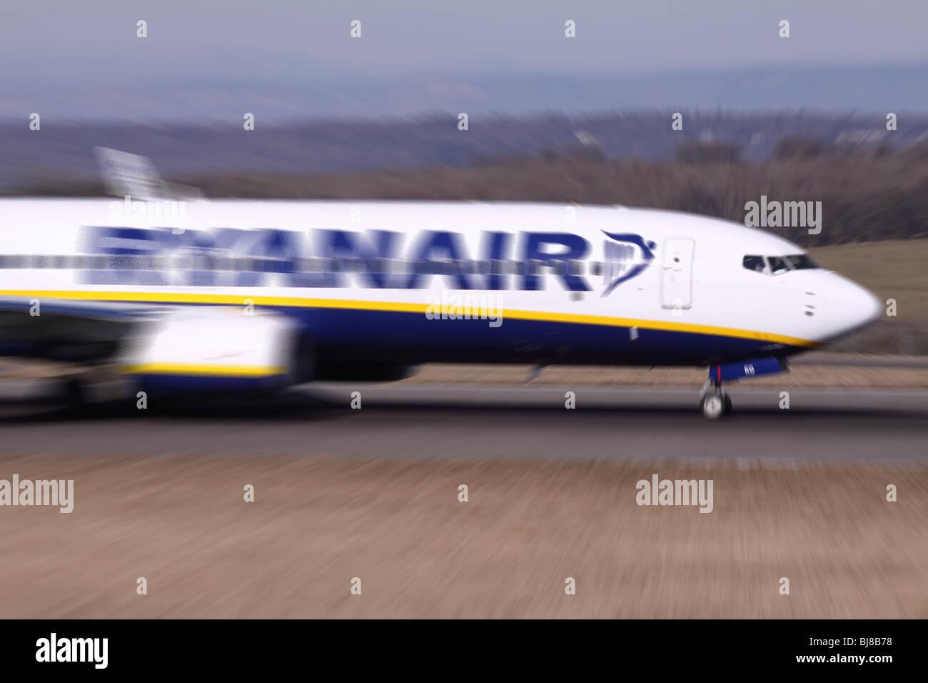 Ryanair plane Boeing 737 taking off motion blur Stock Photo