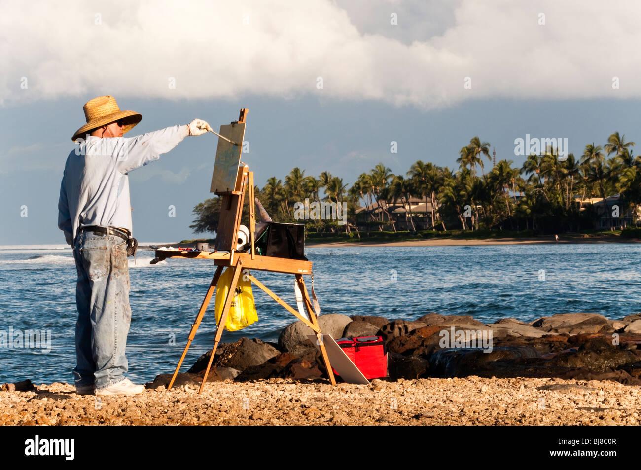 'Plein Air' artist painting at Lahaina Harbor Maui Hawaii.  Molokai in the background - Stock Image
