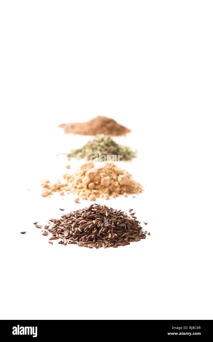 Four piles of spices. Shallow d o f - Stock Image