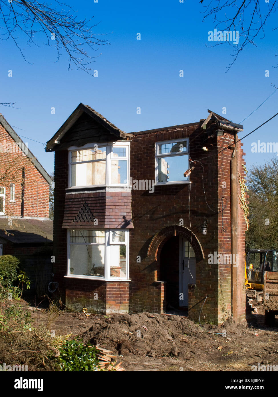 Cheshire, Mottram St Andrew, 1930 detached house being demolished to redevelop the site - Stock Image