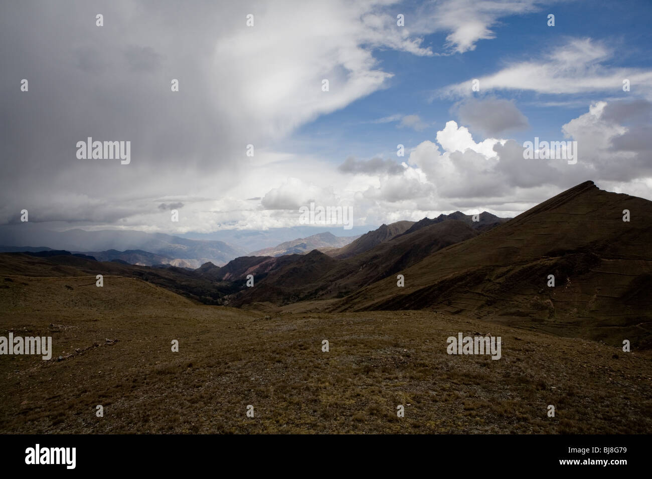 Mountains and sky in Bolivia, north of lake titikaka, south america - Stock Image