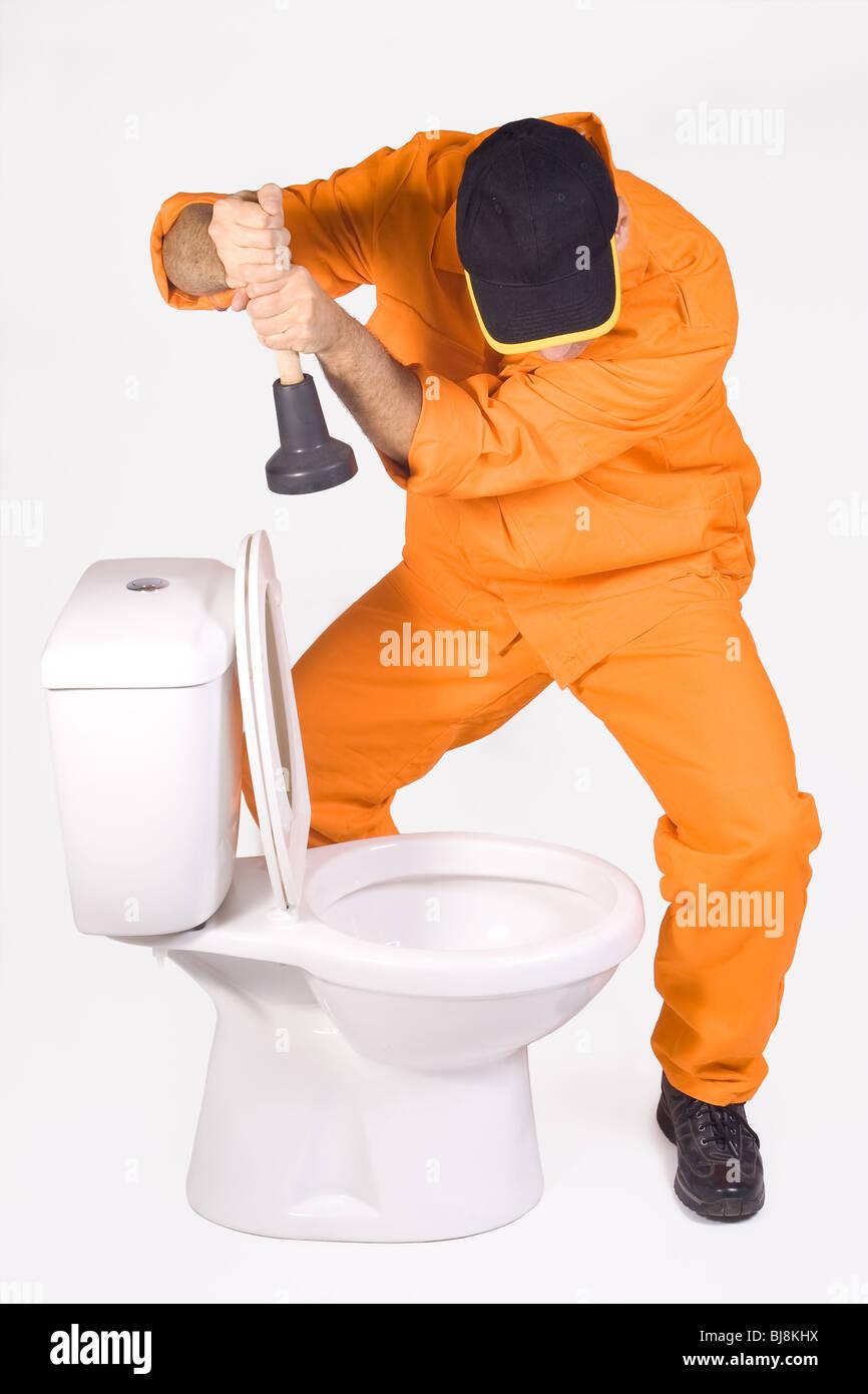 plumber with toilet bowl Stock Photo: 28465190 - Alamy