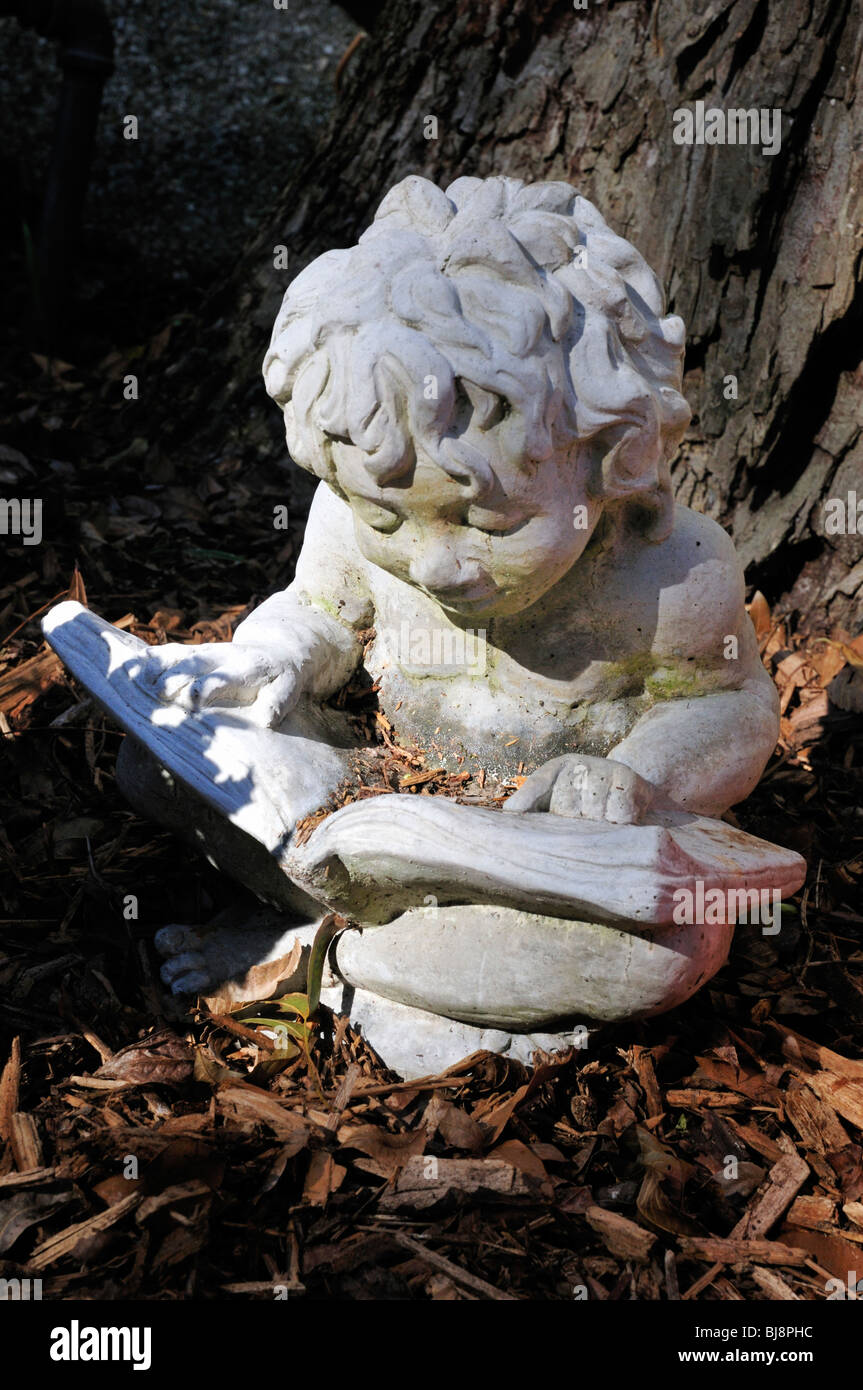 Statue Of A Little Boy Reading A Book In A St. Augustine, Florida Garden