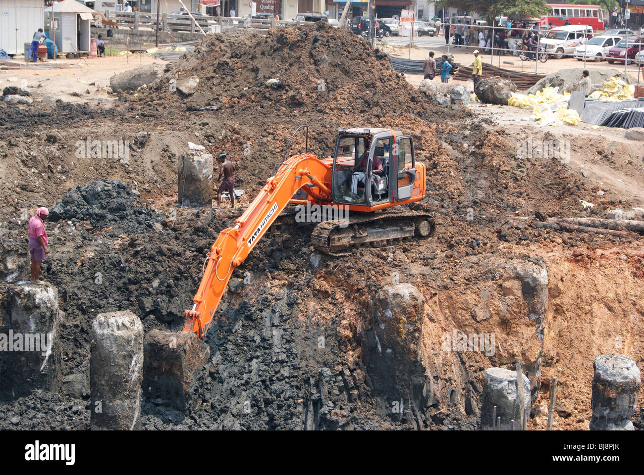 Environmental Impact and Hazards.Deeply Excavating soil for construction purpose using a Big JCB crane.Cochin City, - Stock Image