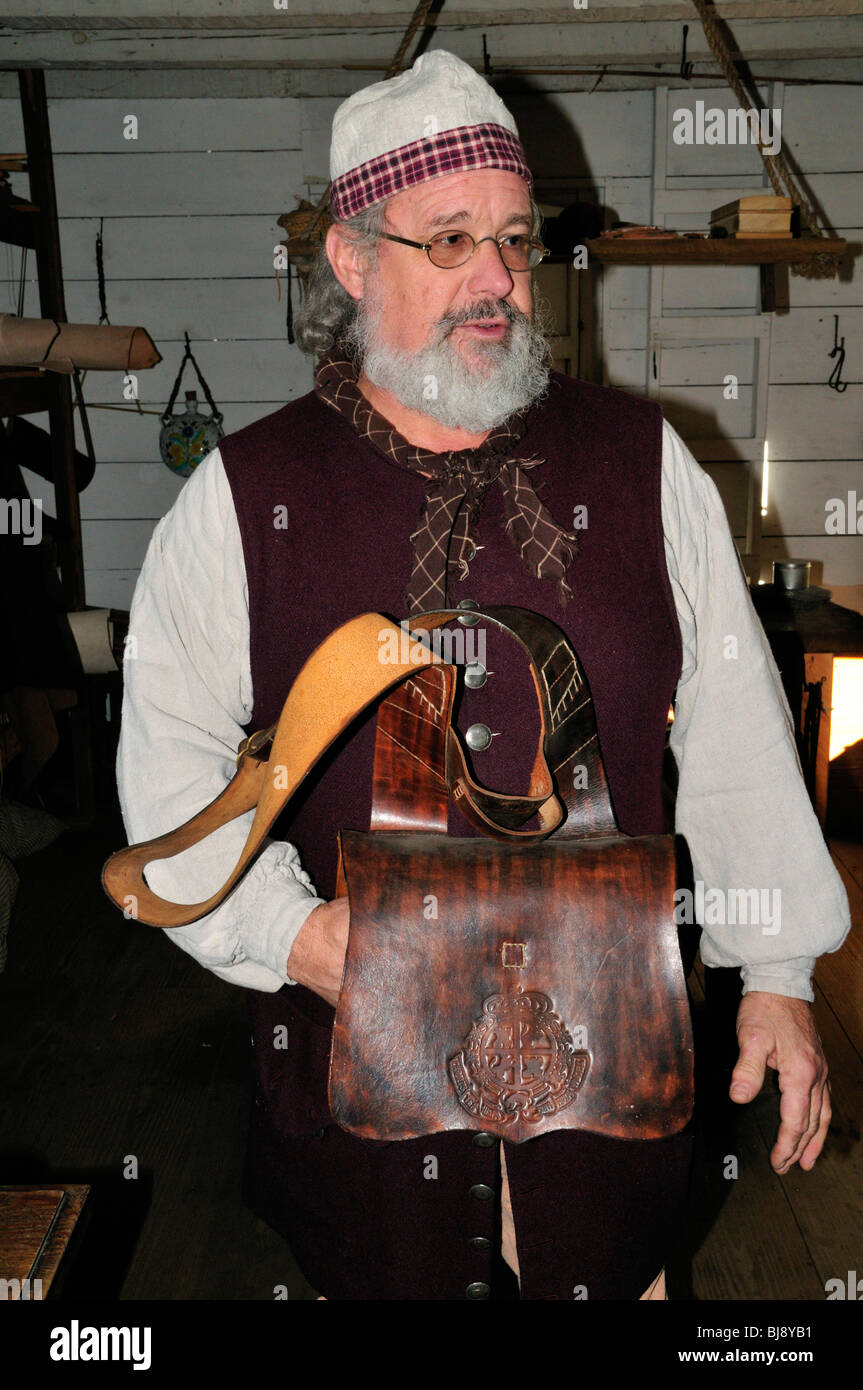Craftsman at St. Augustine's Spanish Quarter holds a leather cartridge carrier of the type used by 18th century - Stock Image
