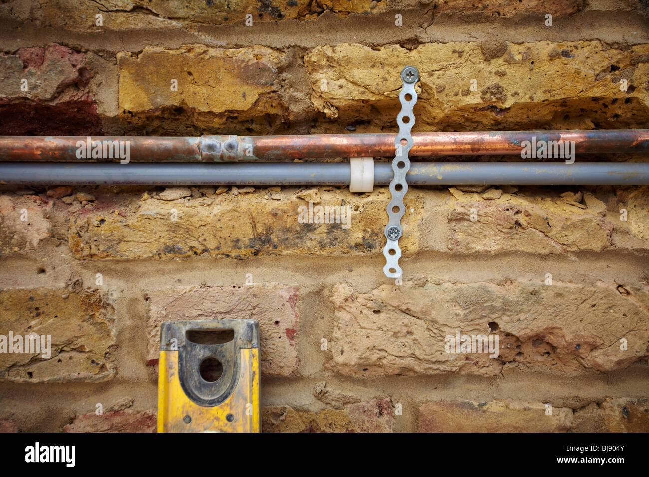 Plumbing pipes in wall chasing - Stock Image
