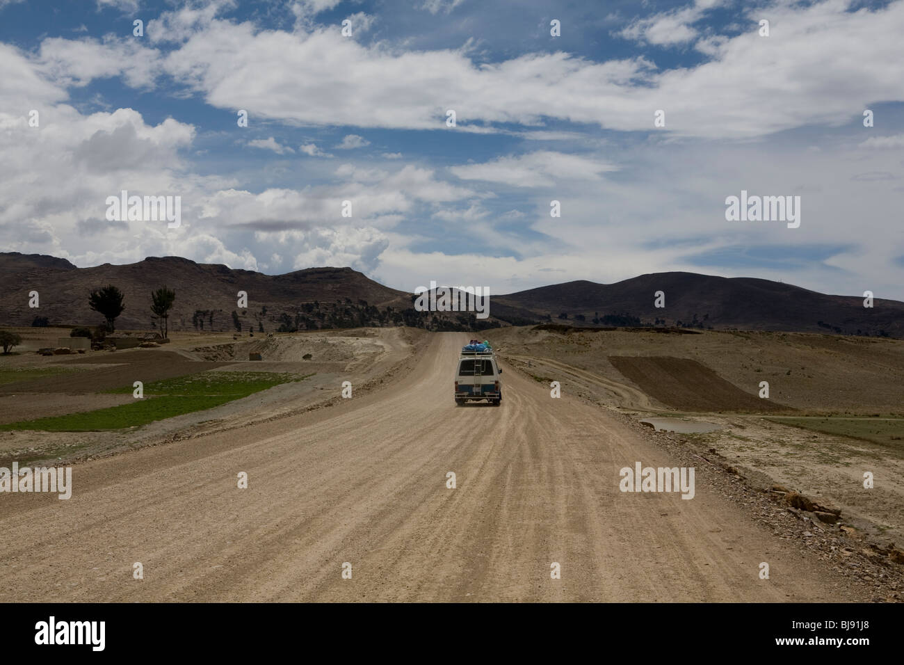 Van driving along dusty road on the bolivian alto plano - Stock Image