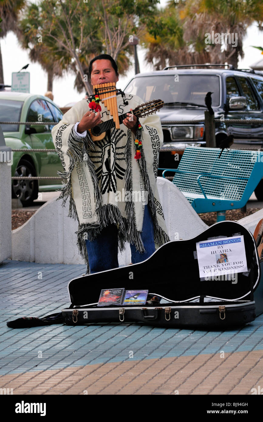 A street performer plays Andes music in the Times Square section of Fort Myers Beach, Florida - Stock Image