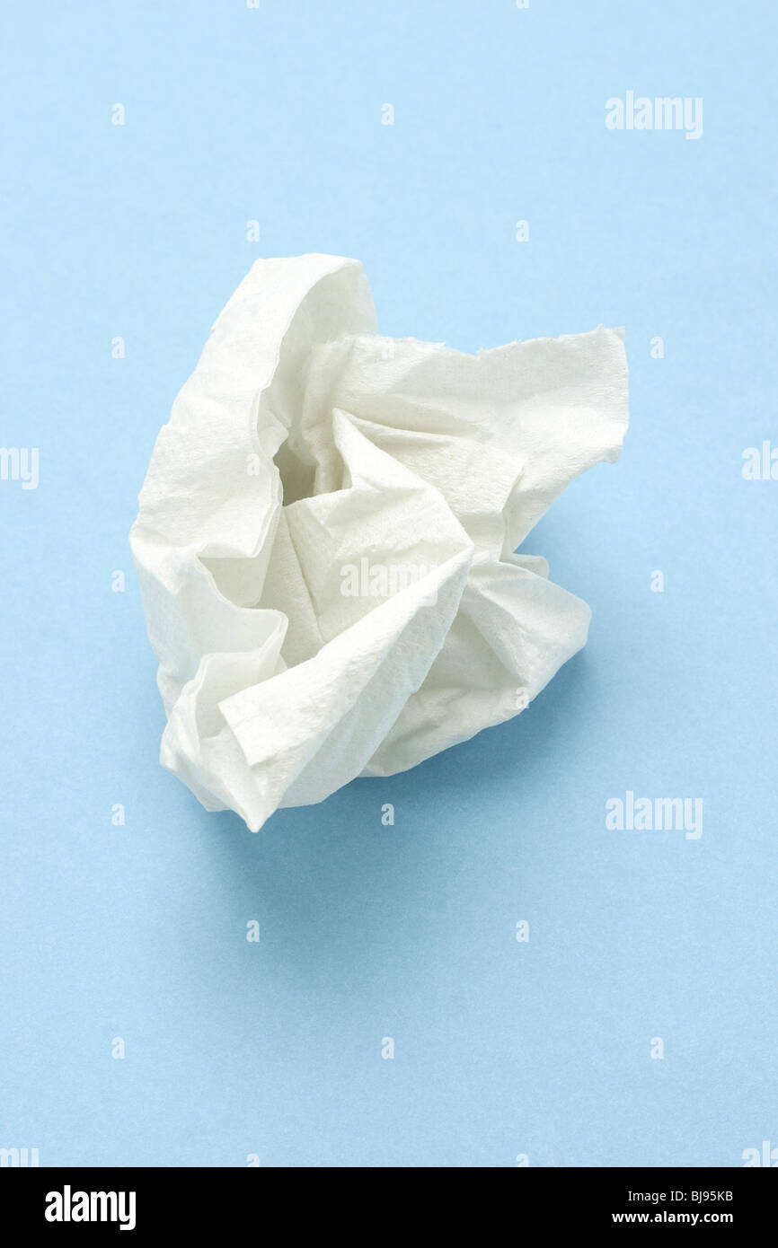 Crumpled two ply tissue paper on blue seamless background - Stock Image