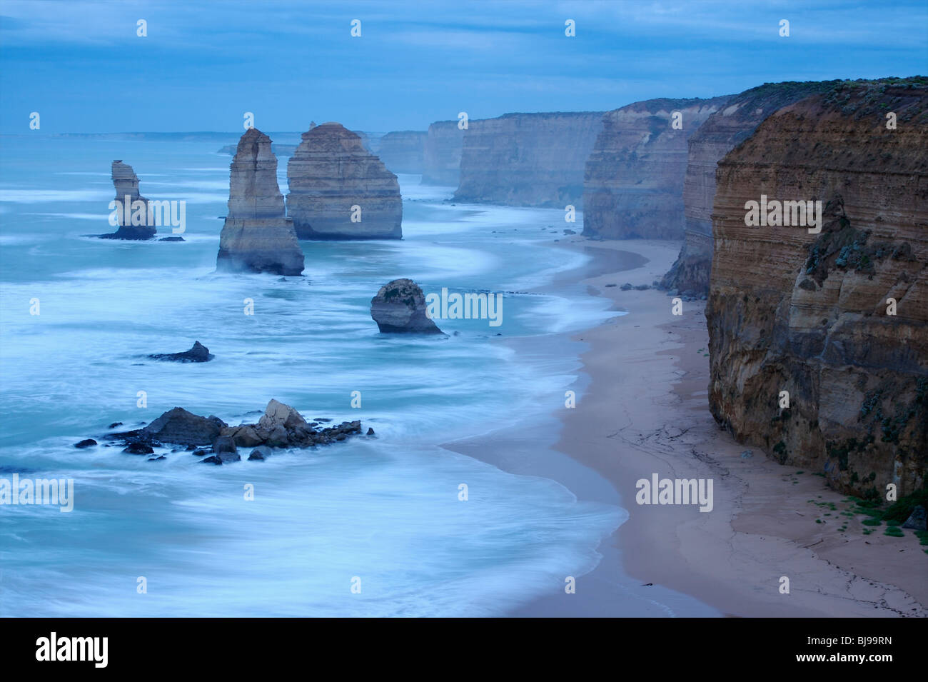 The sky was becoming brighter and another day was about too start at the Great Ocean Road in Victoria, Australia. Stock Photo