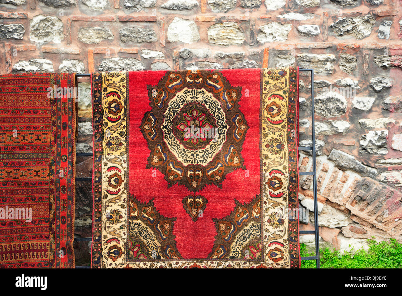 Turkish Carpets and Rugs for sale, Sultanahmet District, Istanbul, Turkey - Stock Image