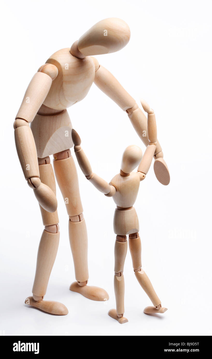 Meeting of parent and child. Wooden fellows on a white background. - Stock Image