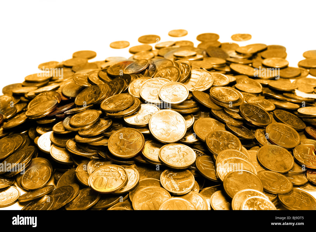 Pile of golden coin over white - Stock Image