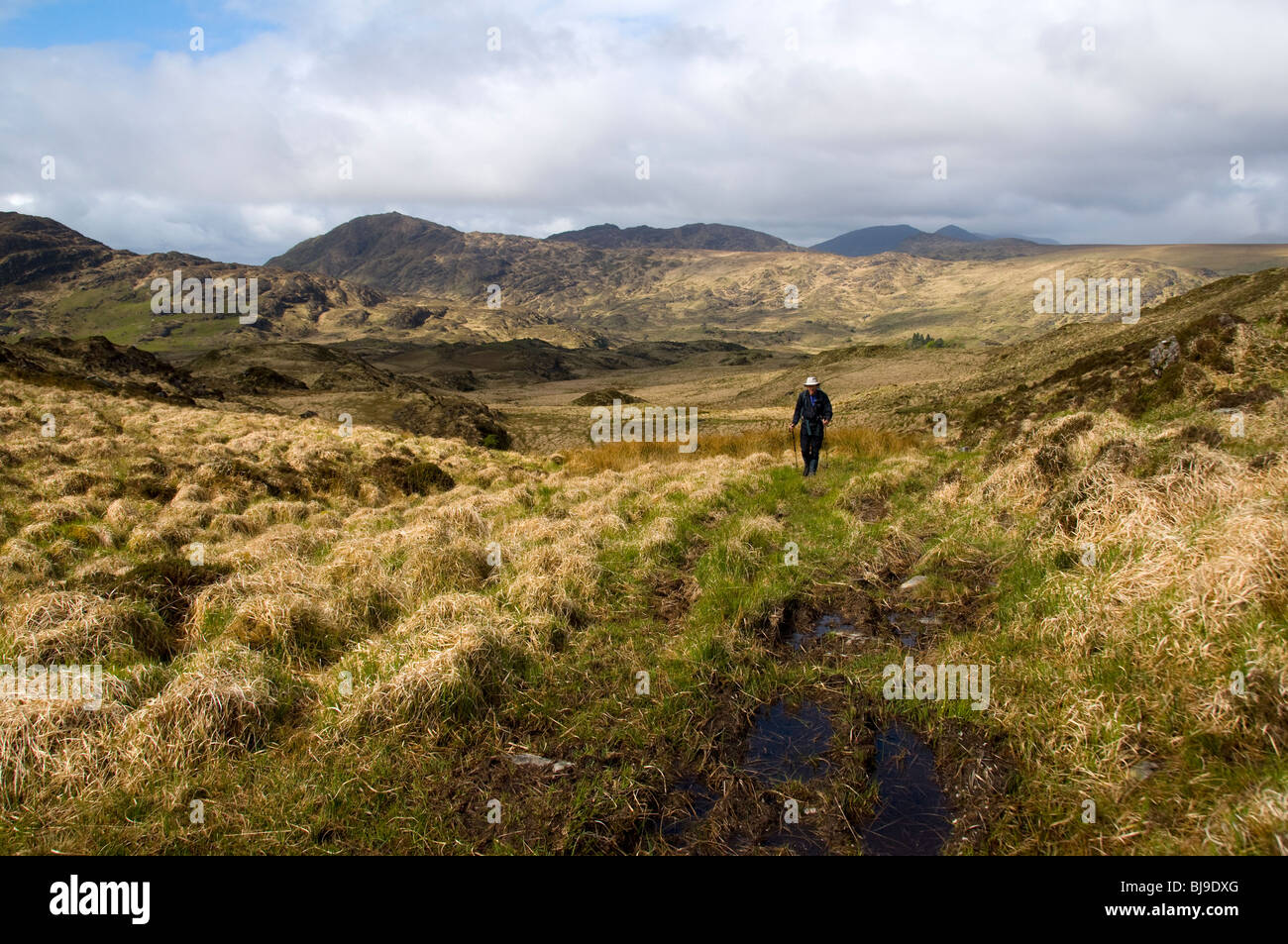 A walker on old track in the Kenmare Uplands, County Kerry, Ireland Stock Photo