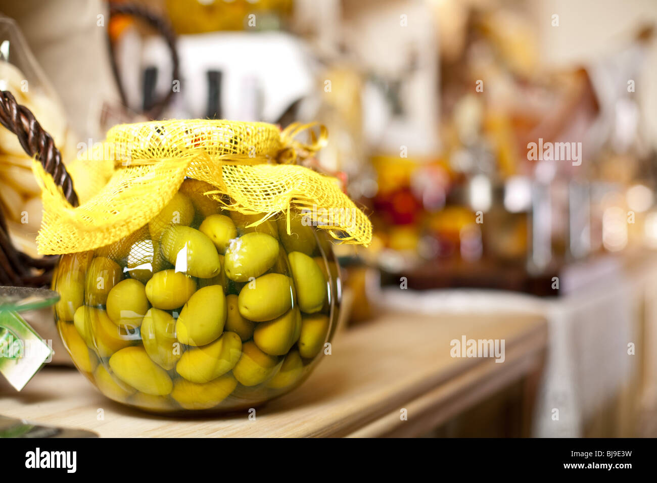 glass jar with green olives - Stock Image