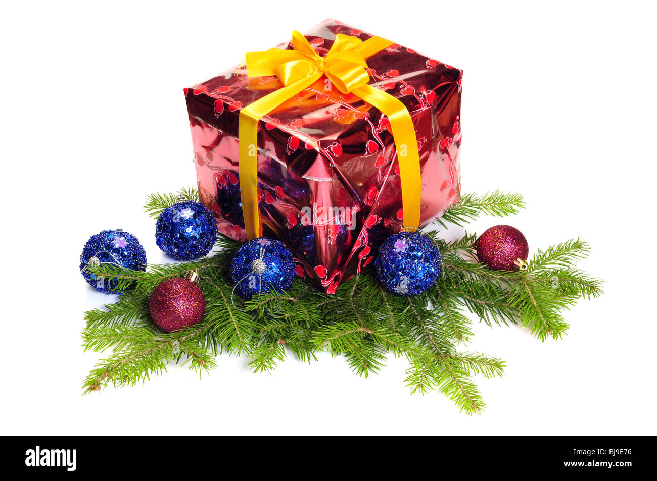 Gift box and Christmas decoration over white - Stock Image