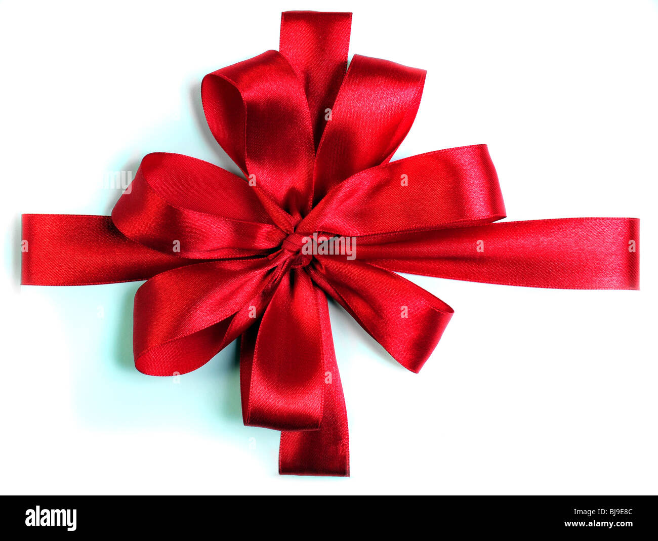 red ribbon bow on white background - Stock Image