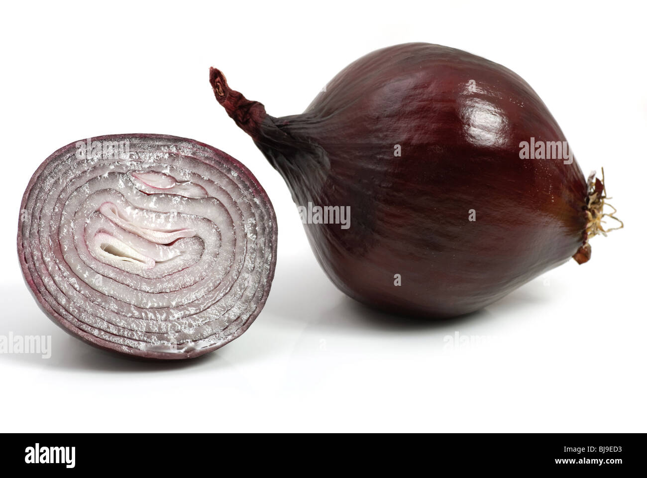Red onion and a half isolated over white - Stock Image