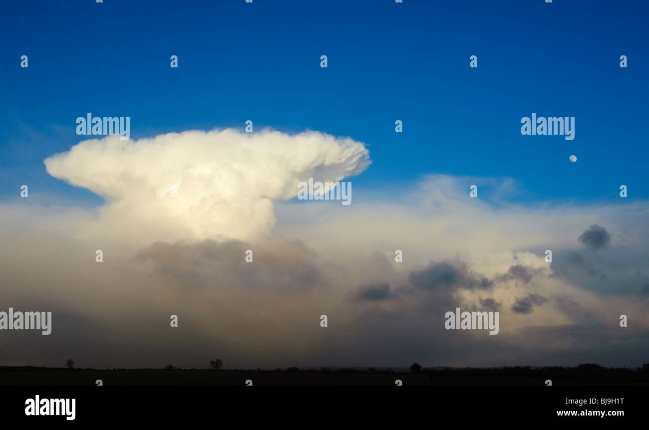 Cumulo-nimbus clouds and full moon near Scarborough, North Yorkshire, England - Stock Image
