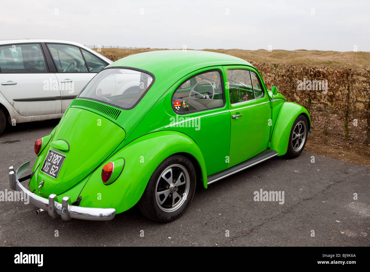 A bright green restored VW Beetle - Stock Image