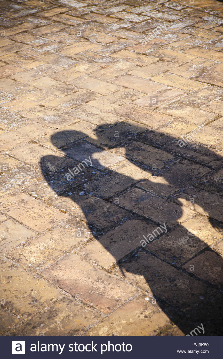The shadow of a couple kissing in love - Stock Image
