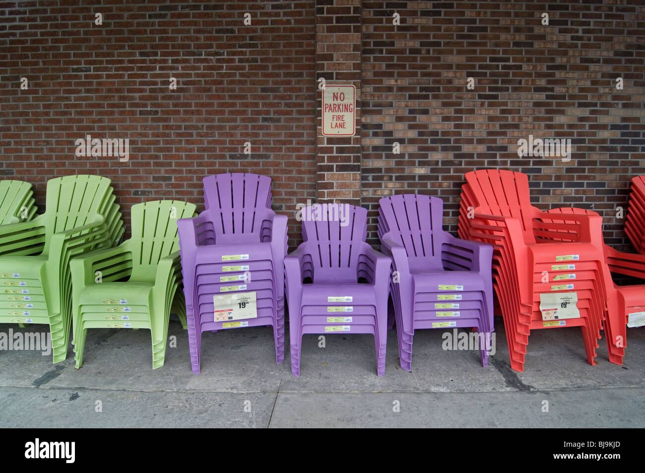Multi Colored Plastic Lawn Chairs For Sale Lined Up In A Row Outside  Grocery Store Florida