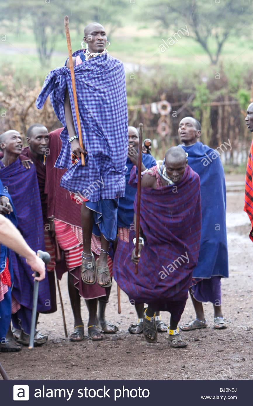 Maasai-men doing their jump-dance. It's part of their manhood to jump high. - Stock Image
