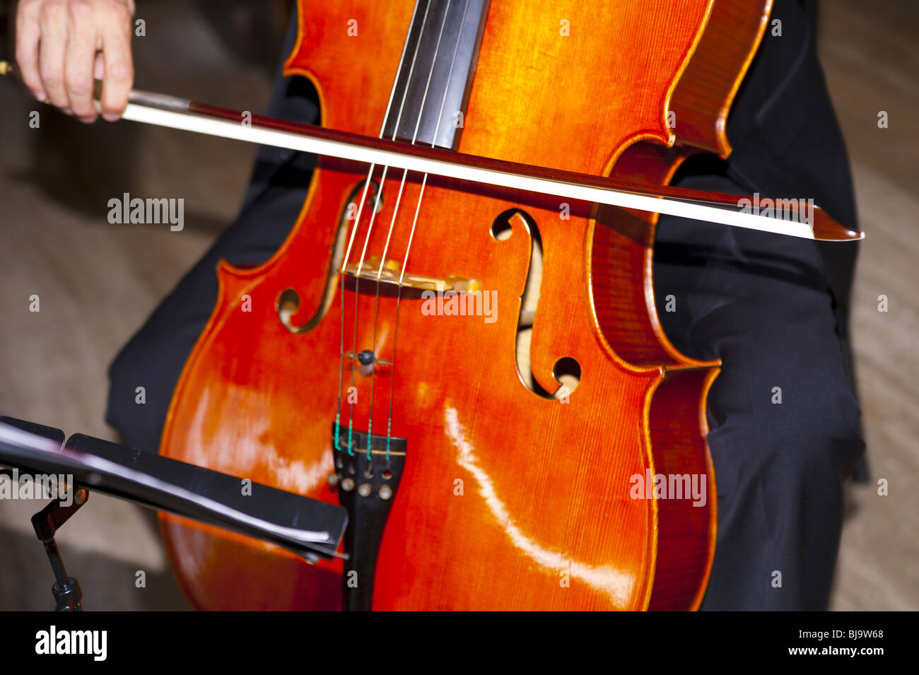 A cello being played - Stock Image