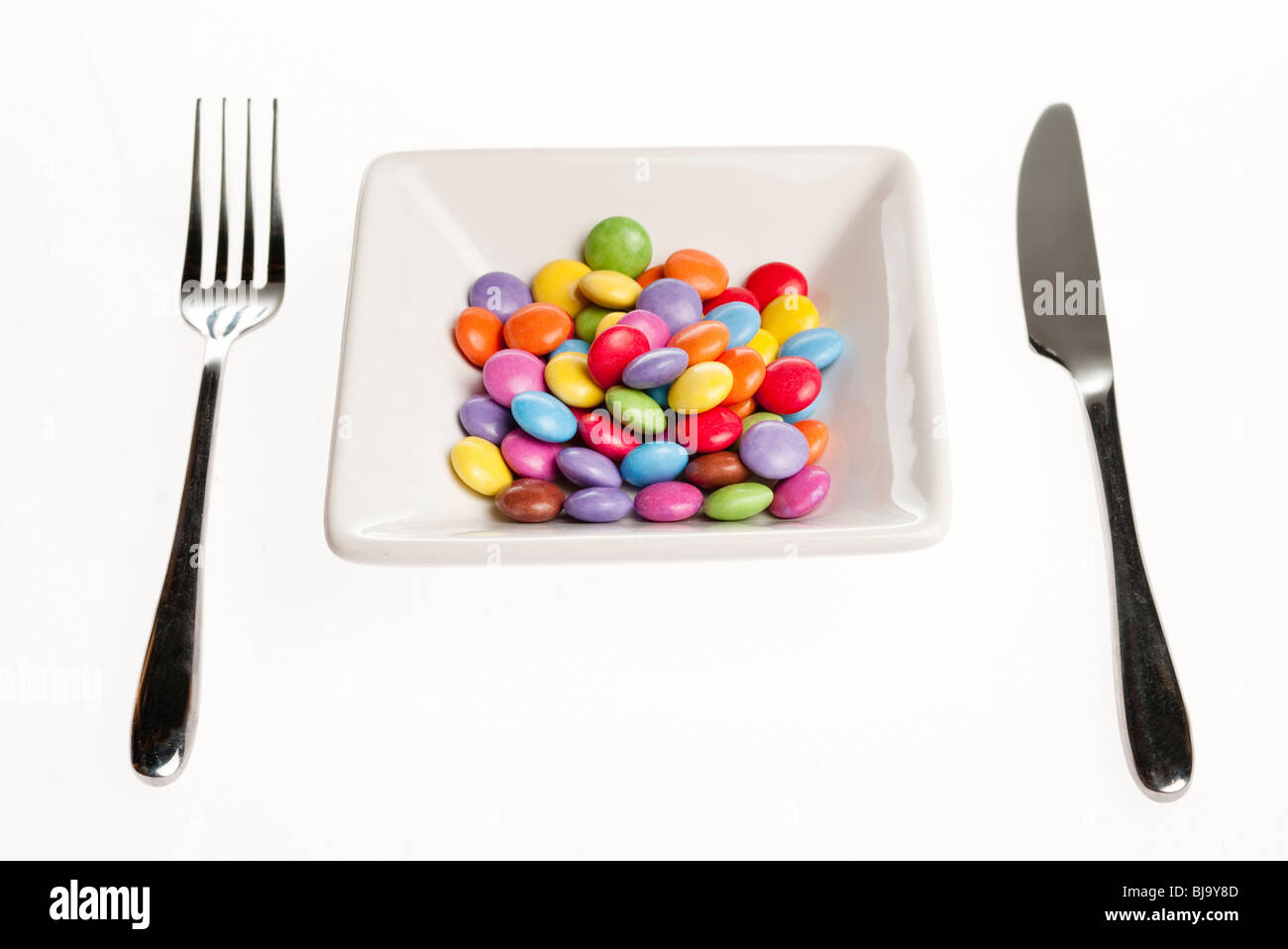 bowl of pills sweets - Stock Image