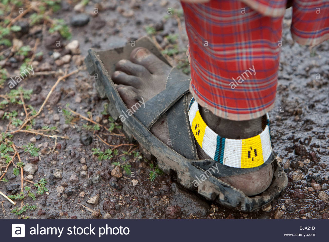 This maasai-mans sandals are made from old used car tires. Tanzania Stock Photo: 28495303 - Alamy