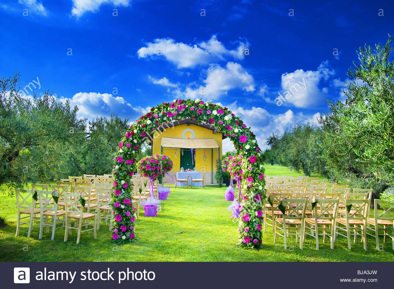 The wedding venue with a flower arch - Stock Image