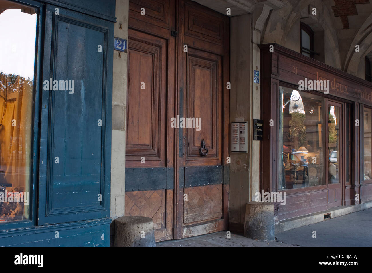 Paris, France, Old Wooden Door to Parisian Building, Place des Vosges, in the Marais - Stock Image