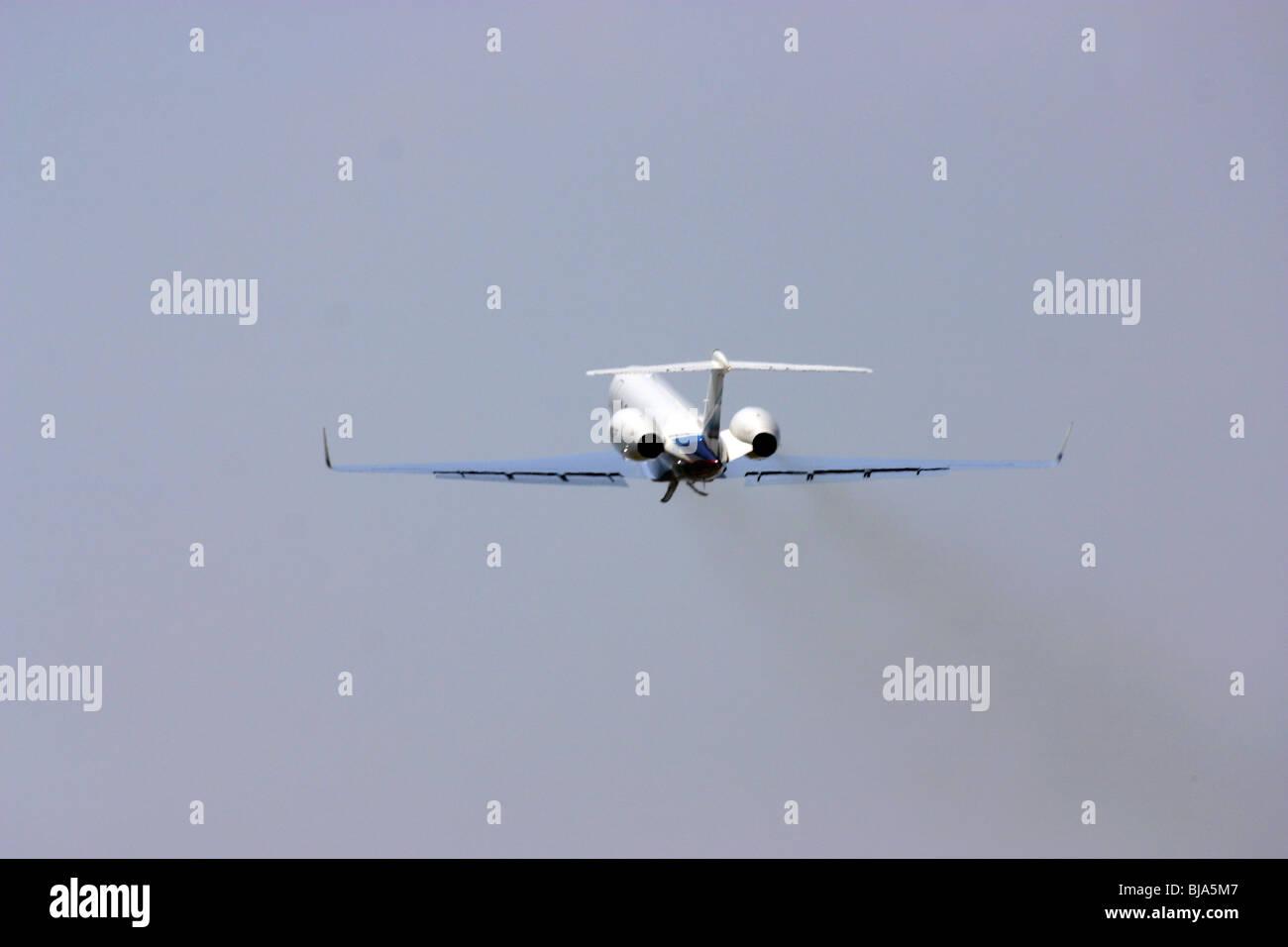 Private Jet,takeoff,aviation,FAA,thrust,engine smoke,jet thrust - Stock Image