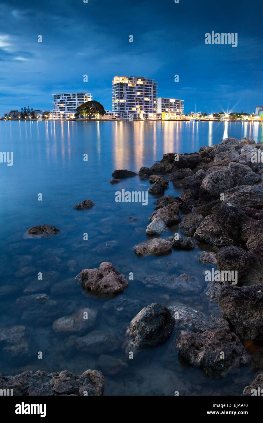 Mandurah, Western Australia. Foreshore apartment buildings reflected in Mandurah Estuary. - Stock Image