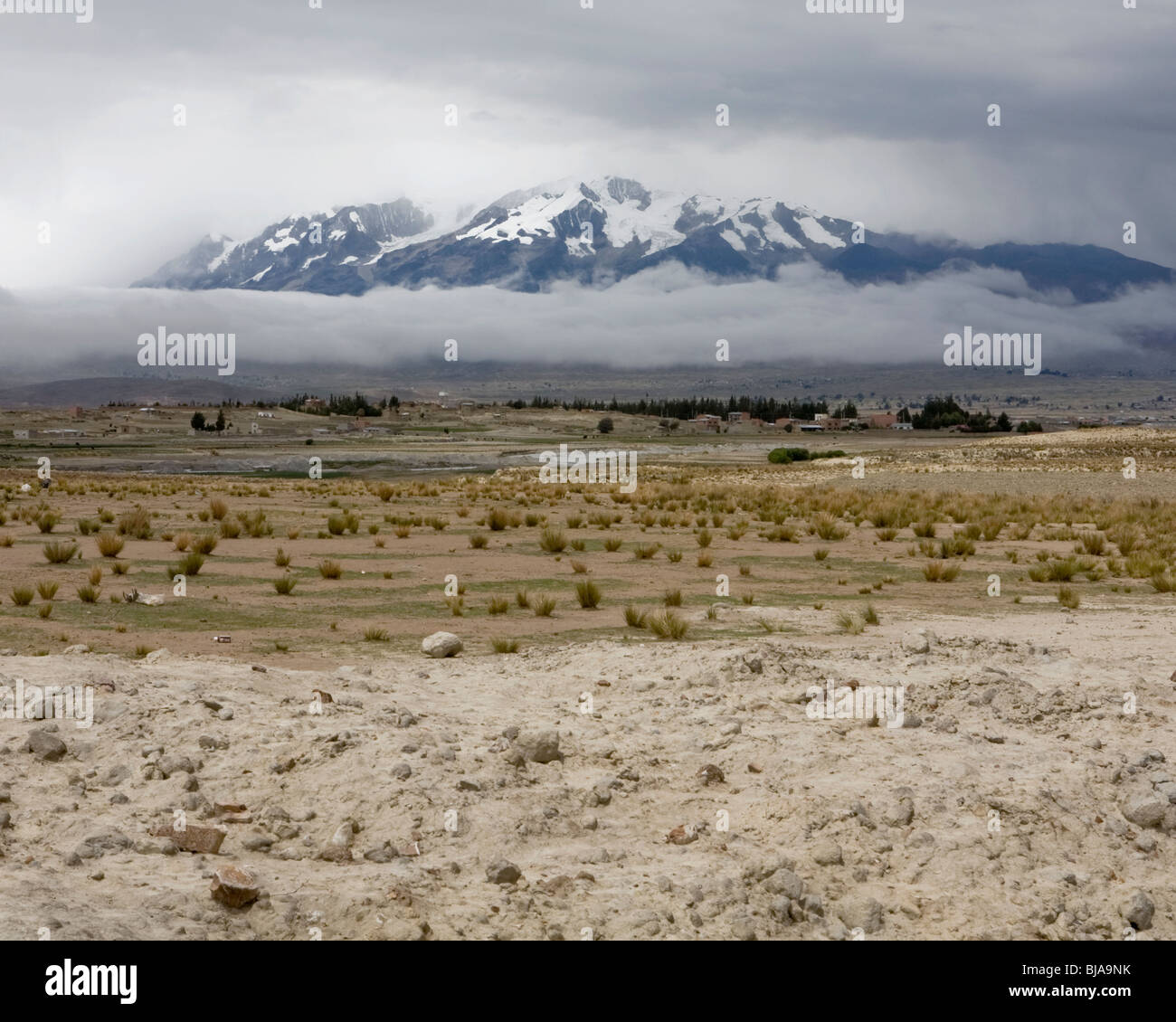 Mountain wrapped in fog, mount Ancohuma, Bolivia - Stock Image