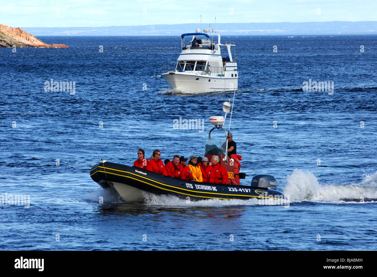 Tourists in a Zodiac dinghy on a whale watching excursion on the St. Lawrence River, Tadoussac, Canada - Stock Image
