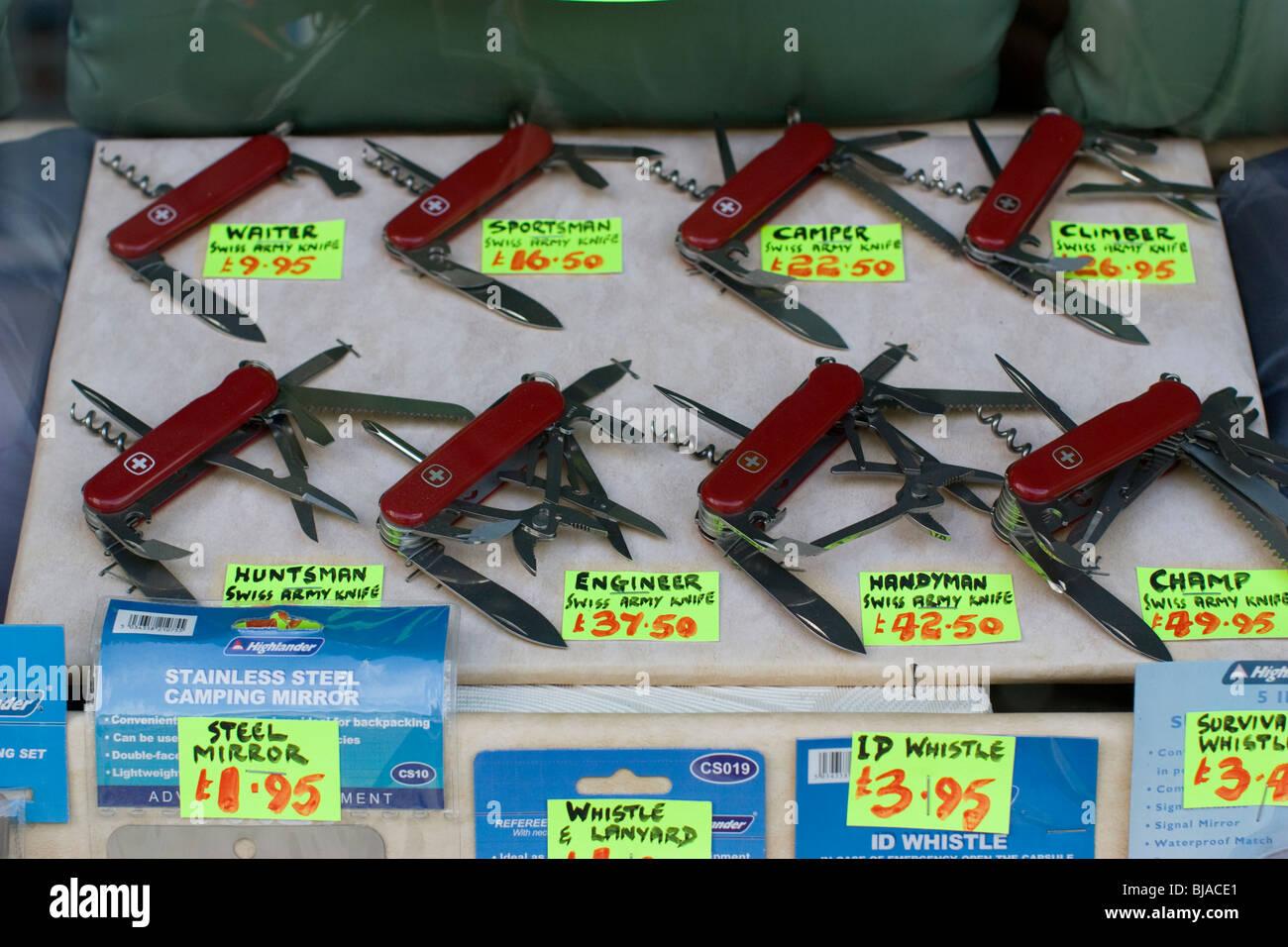 swiss army knife display in shop window UK - Stock Image