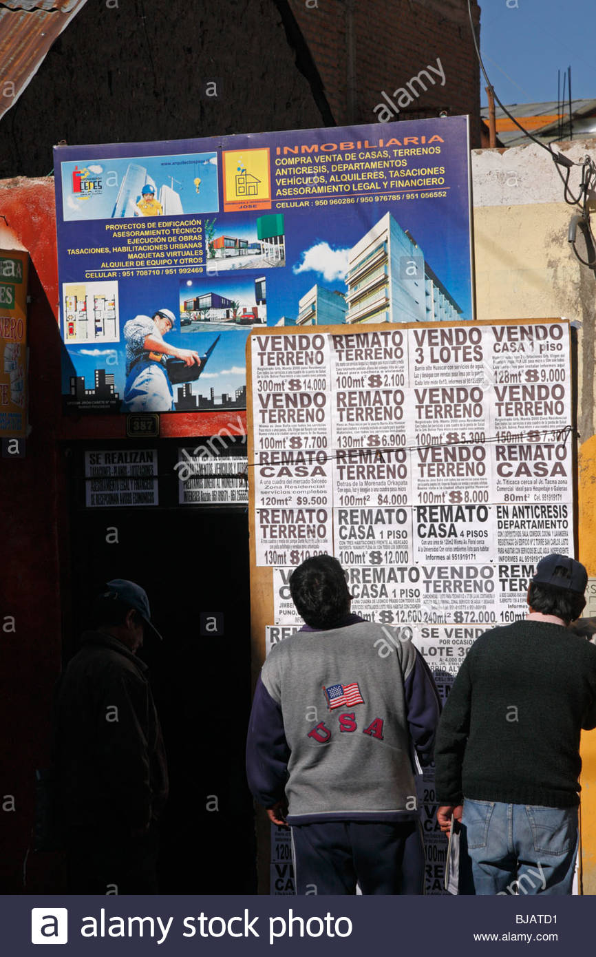 Image of: Dimensi In Puno Peru Men Reading Notices About The Sale Of Apartments In Block Researchgate Under Sign Reading Stock Photos Under Sign Reading Stock