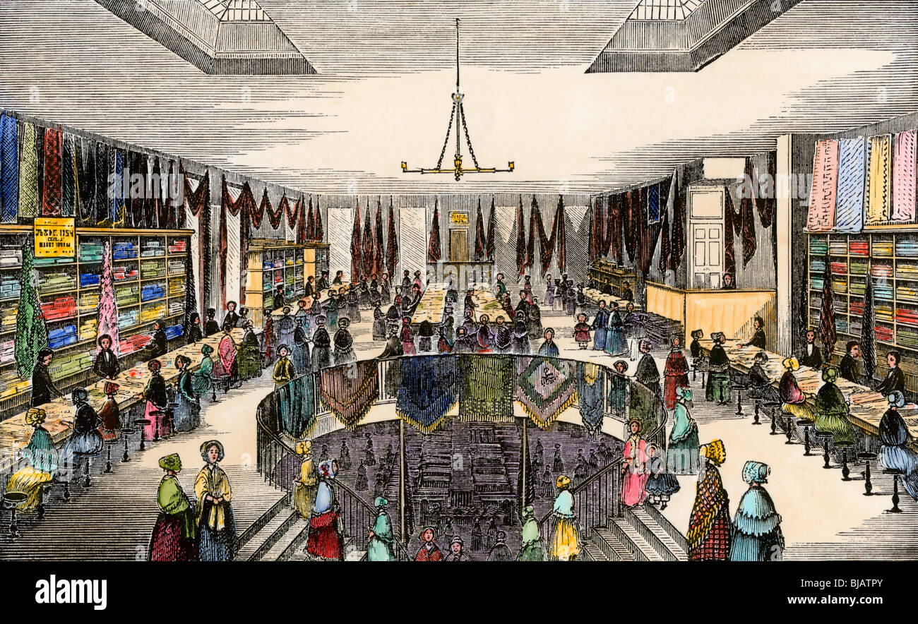 Second floor of Driggs's Lace & Bonnet store in Boston, 1852. Hand-colored woodcut - Stock Image