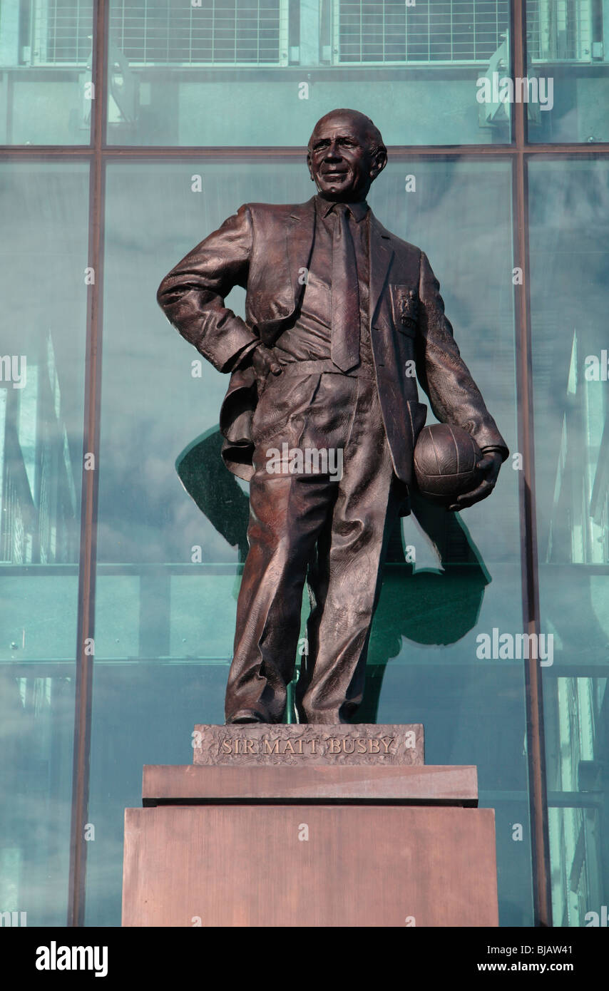 The statue to Sir Matt Busby at the main entrance, East stand, to Old Trafford, home of Manchester United football - Stock Image