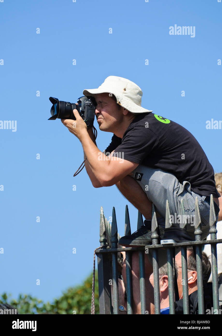 Photographers often take great risks to get the right angle on their subject ... - Stock Image