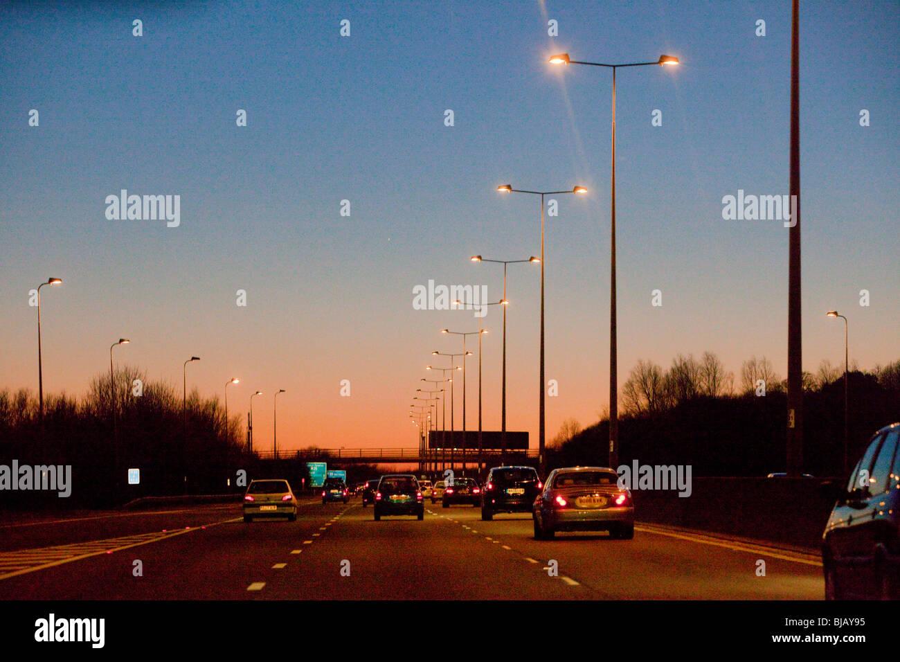 M25 motorway traffic at dusk - Stock Image